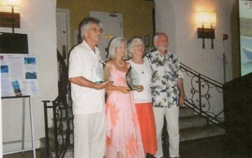 Paul G. Johnson and Dorothy Lee Witwer (president and vice president of Reef Relief) with the Quieros' present trophies of appreciation at the Annual Membership Meeting 2009. Location: Casa Marina Resort in Key West, Florida.